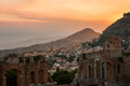 Taormina city during dramatic sunset with the ancient greek amphitheatre sicily island italy Royalty Free Stock Photo