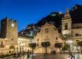 Taormina main square with San Giuseppe Church and the Clock Tower at night - Taormina, Sicily, Italy Royalty Free Stock Photo