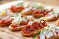 Tapas on crusty bread with fish the Stock Image