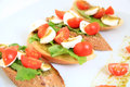 Tapas with mozzarella and tomatoes cherry Royalty Free Stock Image