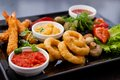 Tapas selection filled pepperoni shrimps mushrooms calamari Royalty Free Stock Images