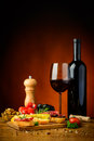 Tapas snacks and red wine still life with traditional spanish Royalty Free Stock Photos