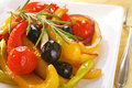 Tapas a spanish vegetable dish baked red and yellow peppers with olives onions and garlic cooked with rosemary and sherry Royalty Free Stock Images