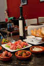 Tapas on table with a glass of wine Stock Photos