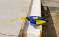 Tape measure on an insulating wall builders being installed in a new build house a building site Royalty Free Stock Photo