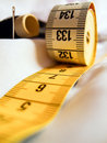 Tape measure, needle, thread Royalty Free Stock Images