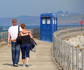 Tardis arrives on kent pier photo of holiday couple looking totally bemused by the sight of the time lords time machine blocking Stock Photography