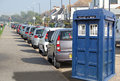 Tardis parked up by kerb photo of the dr who time machine on earth behind cars at kerbside Royalty Free Stock Image