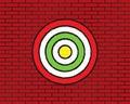 Target or aim, red brick wall