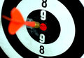Target board with dart arrow red hit the red spot on a circled Stock Image