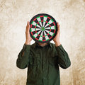 Target head man wholding dartboard in place of Stock Images