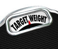 Target weight words scale healthy goal fitness the on a display to illustrate weightloss and reaching a desired for and health in Royalty Free Stock Photos