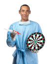 Targeting health care a professional points a needle and syringe to a dartboard suggesting target practice or Royalty Free Stock Photos
