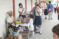 Targeting the sweet tooth las choapas mexico july a woman sells candy to children near entrance of a school as students finish Royalty Free Stock Photo