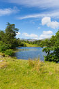 Tarn hows near hawkshead lake district national park england uk on a beautiful sunny summer day the most in the this is one of the Stock Photo