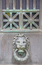 Tarnished brass copper lion head door knob knocker stars aged medallion made of or topped with and bars Stock Images
