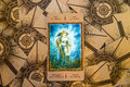 Tarot card Jack of Spades. Labirinth tarot deck. Esoteric background.