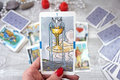 Tarot cards, candles and accessories on a wooden table Royalty Free Stock Photo