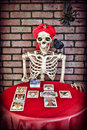 Tarot reading skeleton a doing a card Stock Images