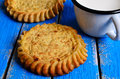 Tart with filling open on a wooden surface Royalty Free Stock Image