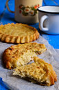 Tart with filling open on a wooden surface Royalty Free Stock Photos