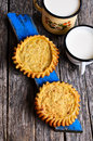 Tart with filling open on a wooden surface Royalty Free Stock Photo