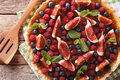 Tart with fresh figs, raspberries and blueberries. Horizontal to Royalty Free Stock Photo