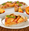 Tart with nectarines on a brown table close up Royalty Free Stock Photo