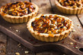 Tart with nuts and caramel on a rustic background Stock Photos