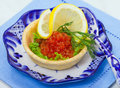 Tart with red salmon caviar Stock Photos
