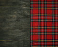 Tartan textile on wooden background Stock Photos