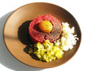 Tartar steak egg onion pickle Stock Photo