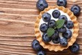 Tartlet with fresh blueberries on a wooden horizontal top view Royalty Free Stock Photo