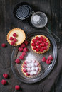 Tartlet with raspberries unfinished and ready to eat tartlets custard sugar powder and fresh served on vintage metal tray baking Stock Images