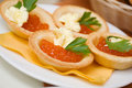 Tartlet with red caviar Royalty Free Stock Photo