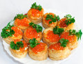 Tartlets with caviar and parsley Stock Photos