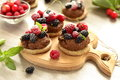 Tartlets with chocolate mousse and berries fresh summer Stock Image
