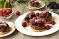 Tartlets with chocolate mousse and berries fresh summer Stock Photo