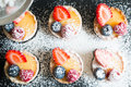 Tartlets of fresh berries and icing sugar Royalty Free Stock Photo