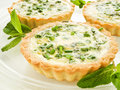 Tartlets with green peas cheese eggs and mint shallow dof Royalty Free Stock Image