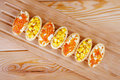 Tartlets with red caviar and corn Royalty Free Stock Image