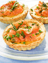 Tartlets smoked salmon eggs cheese green onion shallow dof Royalty Free Stock Photos