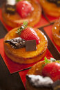 Tarts with chocolate and strawberry on top in party Stock Photo