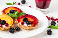 Tarts with froots on the white dish Royalty Free Stock Photography