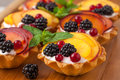 Tarts with froots on the wooden desk Royalty Free Stock Photo
