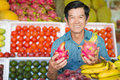 Taste it portrait of a senior man with exotic fruits in hands on the foreground Royalty Free Stock Photos