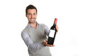 Taste red wine happy winegrower showing bottle to camera Royalty Free Stock Photography