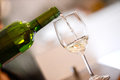 Tasting-White wine pour in a glass Royalty Free Stock Photo