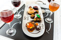 Tasting of wine and pattie chocolate pastries at the chocolate. Royalty Free Stock Photo