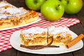 Tasty apple cake with green apples on the table Stock Image